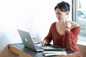 A woman watches a video from a social media video marketing campaign