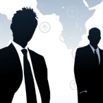 silhouette of business men in front of a map
