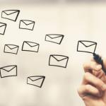Man drawing email envelopes