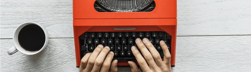 Writing ad copy on a typewriter